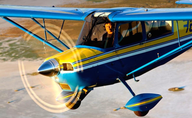 small blue airplane in flight aircraft appraisal